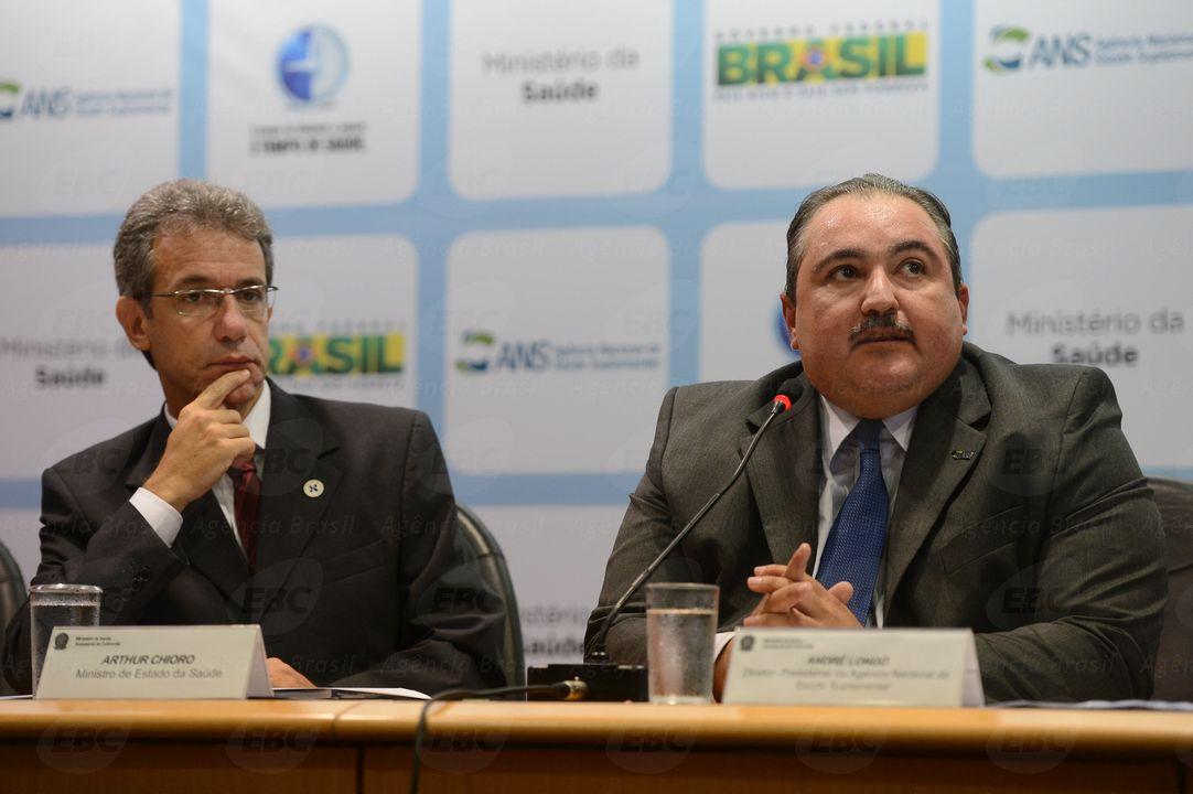 Arthur Chioro, ministro da Saúde e André Longo, presidente da ANS